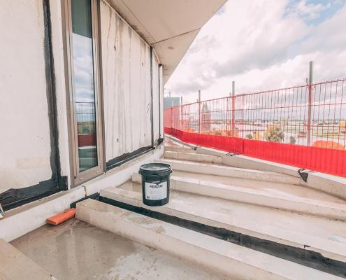 Air barrier with liquid rubber high-rise